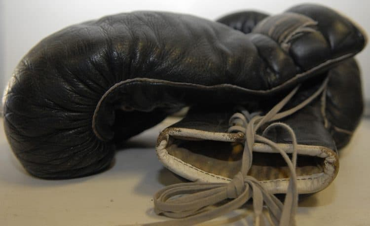 A big pair of black boxing gloves
