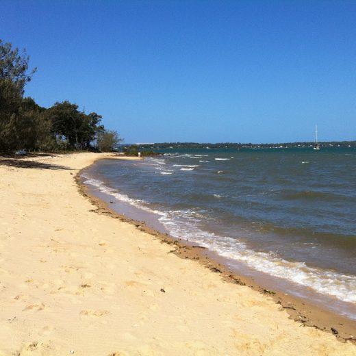 A deserted shore line of a beach
