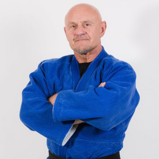 kevin O Hagan arms crossed dressed in his martial arts outfit and black belt