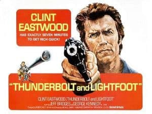 The thunderbolt and lightfoot film poster featuring Clint Eastwood pointing a gun.
