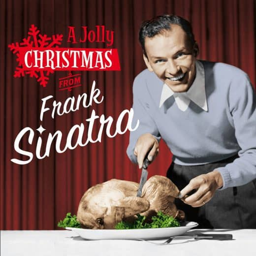The cover of 'Christmas with Frank Sinatra' album. Frank is pictured about to carve a turkey with a grin on his face