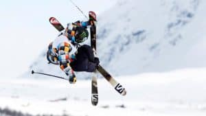 Picture of James 'Woodsy' Woods in flight mid-trick with his skis crossed