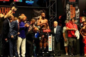 Boxer Floyd Mayweather stands on the scales at a weigh in at MGM Grand
