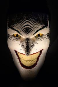 A close up of a sculpture of the supervillain The Joker. The Joker is giving a demonic grin. Photograph © Jane Hobson.