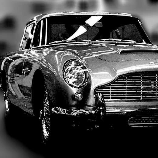A shiny Astin Martin DB5 photographed in black and white