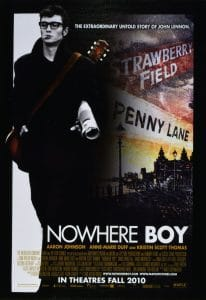 Poster of the film Nowhere Boy. A full length photograph of actor Aaron Johnson's Portrayal of Beatle John Lennon takes up the left hand side of the picture. The right hand side has a drawing of the Liverbird building in Liverpool and iconic street signs Strawberry Fields and Penny Lane