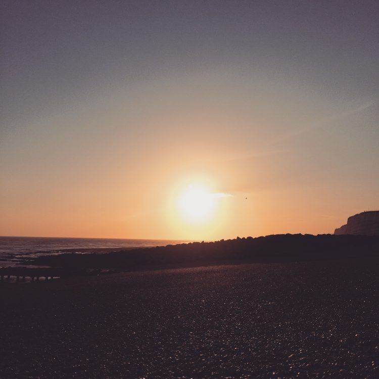 Picture of the sun setting in Brighton over the sea