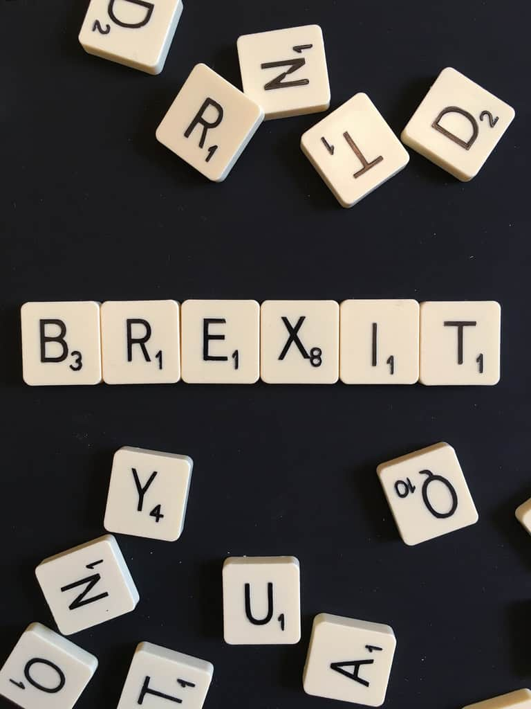 The word BREXIT spelt out using Scrabble tiles