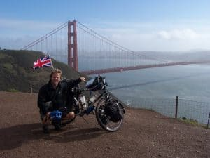Tom with his bike overlooking the Golden gate bridge in America