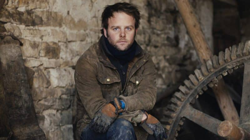 Tom Kevill-Davies sat in an old country barn surrounded by farming tools and equipment