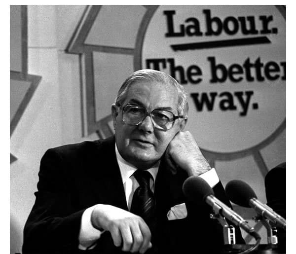 Former PM Jim Callagnan sits at a desk with fist on side of his face. The slogan Labour The Better Way is seen behind him. Pic appears in Peter Spencer's State of the Nation piece