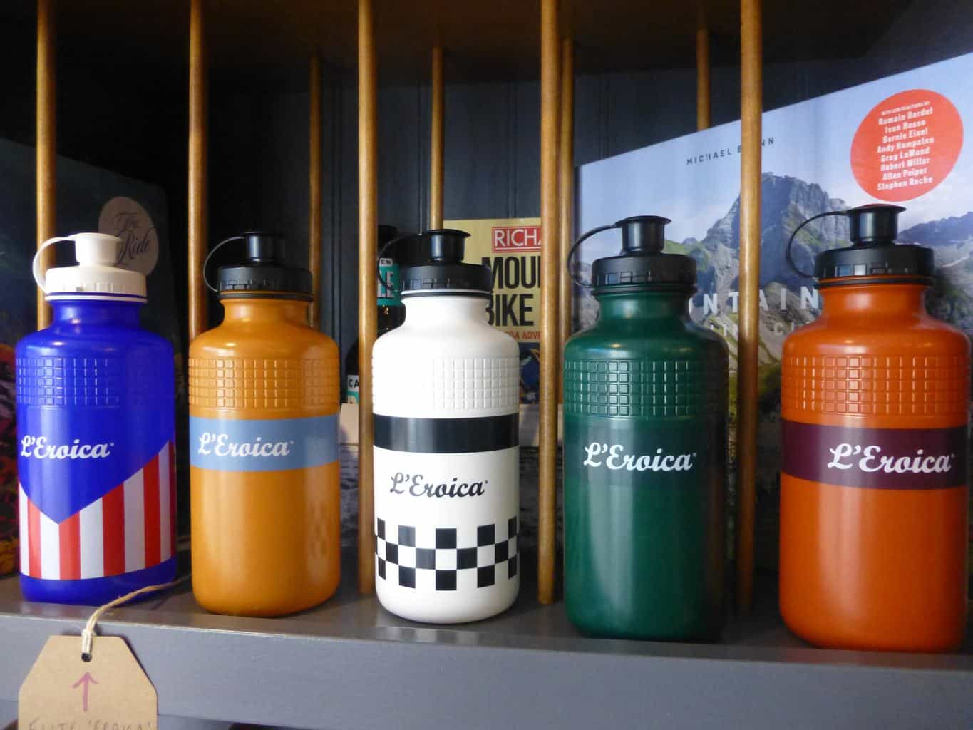 5 L'Eroica Water Bottles on a shelf in a cycling shop