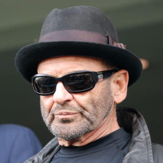Goodfellas star Joe Pesci wearing shades and a pork pie hat