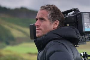 Gordon Buchanan with a camera in the mountains