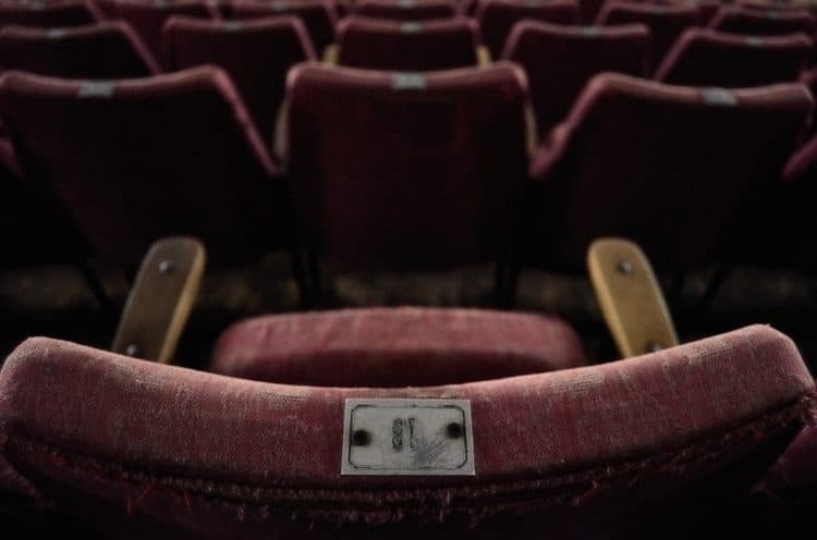 A worn out old cinema chair