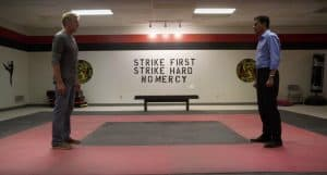 Daniel LaRusso and Johnny Lawrence square off at the Cobra Kai gym