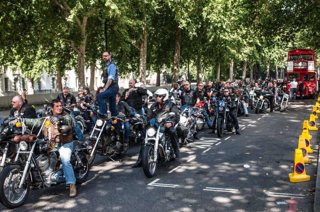 A procession of motorcycles make their way through the London traffic