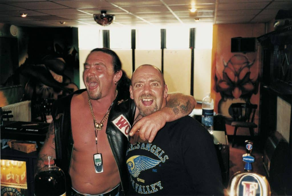 Two Hell's Angels members celebrate in a bar