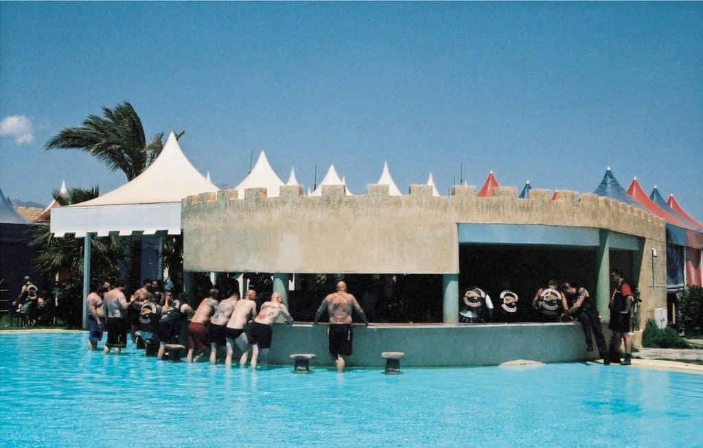 Hell's Angels members surrounding a poolside bar in Benidorm