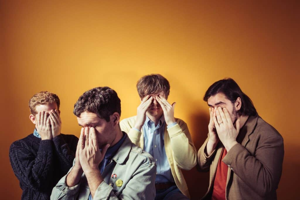 Parquet Courts covering their eyes