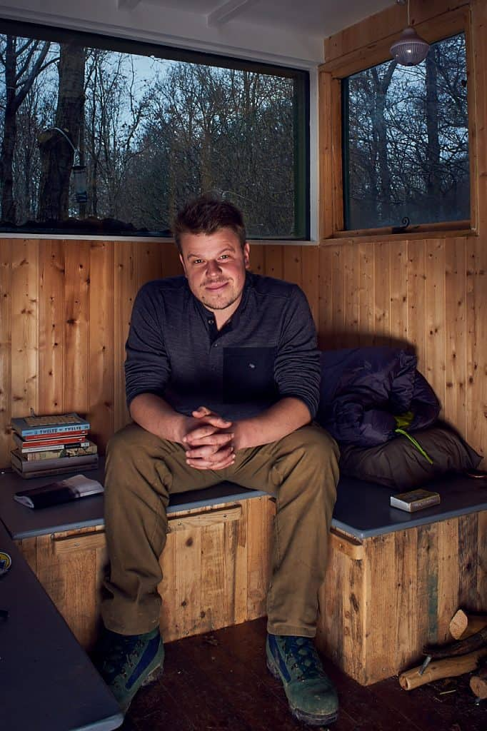 Dave Erasmus seated in his sustainable house