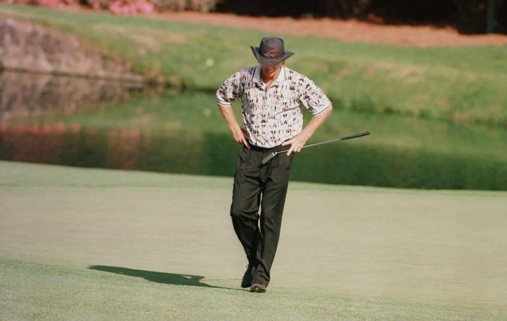 A dejected Greg Norman on the green
