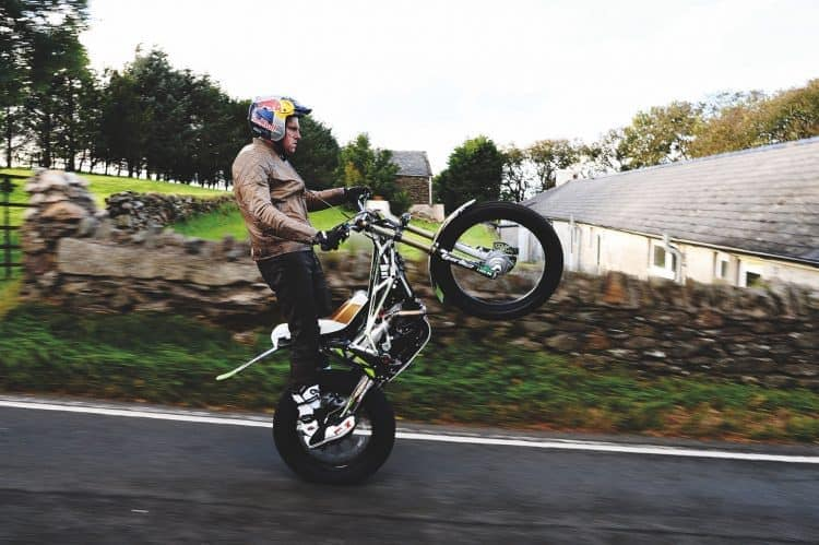 Dougie Lampkin attempting to wheelie full TT Course
