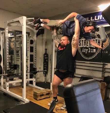 Strongman Eddie Hall lifting a soundman over his head