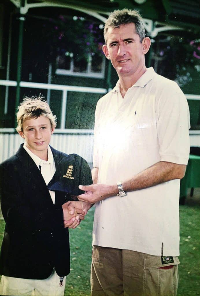 A young James Taylor with cricketer Andy Caddick