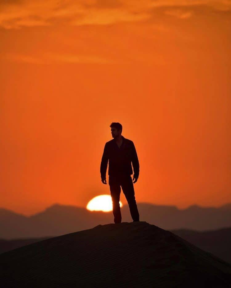 Jeremy Jauncey stood atop a mountain as the sun sets