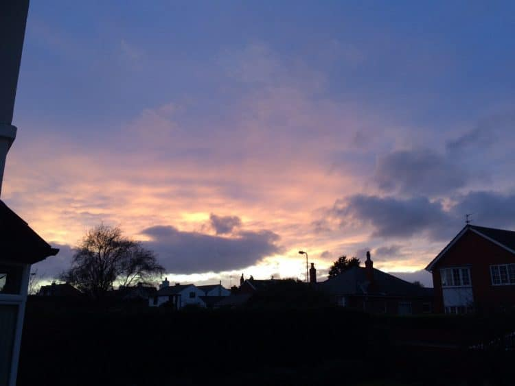 A photograph of the night sky as the sun sets