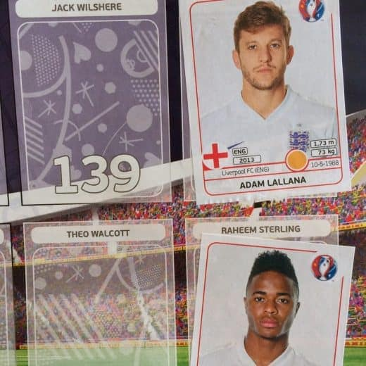 An Euro 2016 stcker album featuring England players Adam Lallana and Raheem Sterling