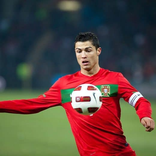 Ronaldo in red about to give a ball a kick