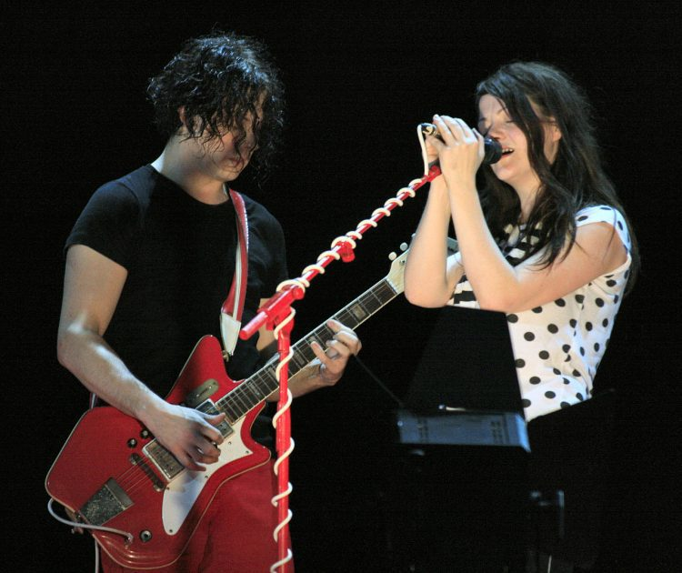 The white stripes on stage performing at a gig