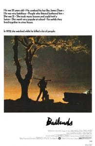 The badlands film poster featuring a dusty desert and a man holding a shotgun over his shoulder