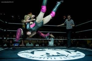 A picture of Pollyanna doing a sit out brainbuster in the middle of a Progress ring. Pic by Rob Brazier Jr