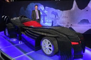 LEGO artist Nathan Sawaya stands in front of his LEGO made Batmobile Photograph © Jane Hobson.