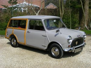 A grey Morris Mini Traveller parked in a driveway