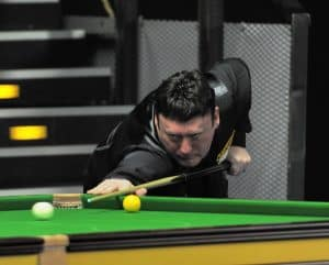 Snooker player Jimmy White lines up to take a shot on a snooker table