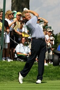 Golfer Colin Montgomerie swings a club behind his back during a Ryder Cup match in America
