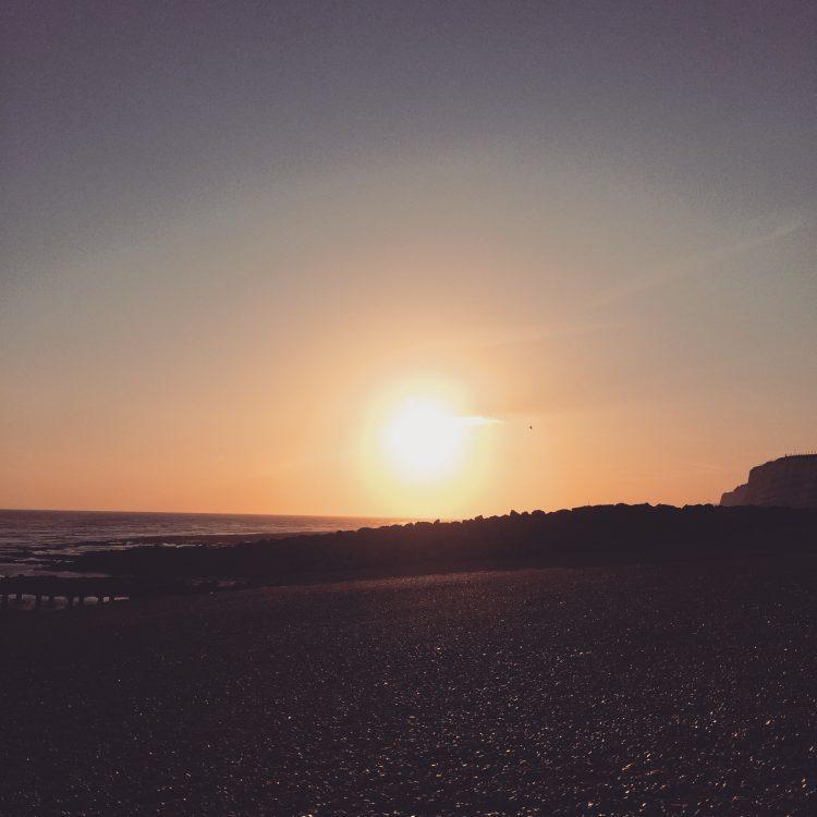 Picture of the sun setting in Brighton over the sea