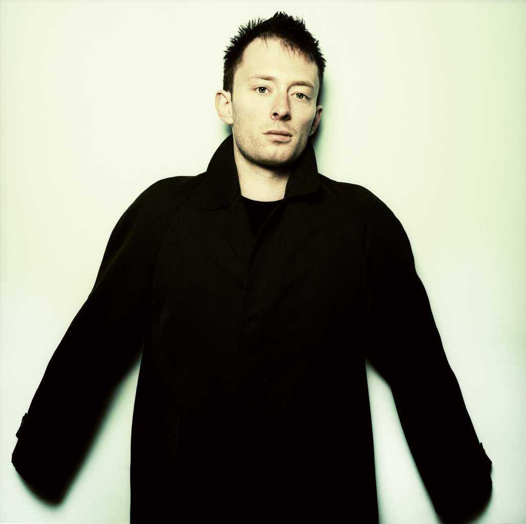 Picture of Thom Yorke in France, October 1997. He wears a fur coat and looks slightly off camera to the left