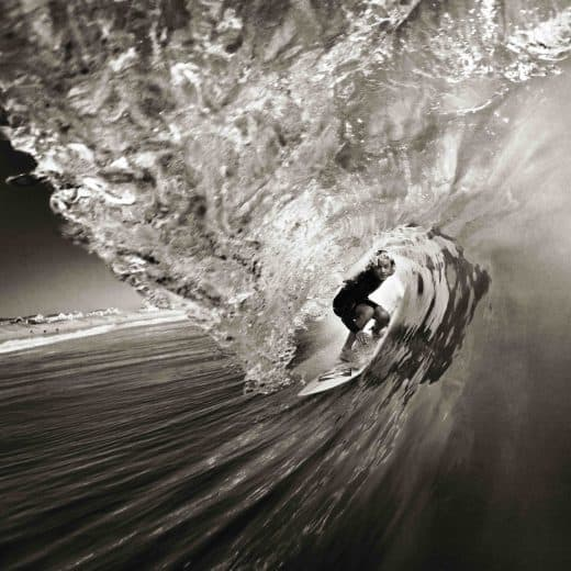 Surfer in barrel by surf photographer Chris Bickford