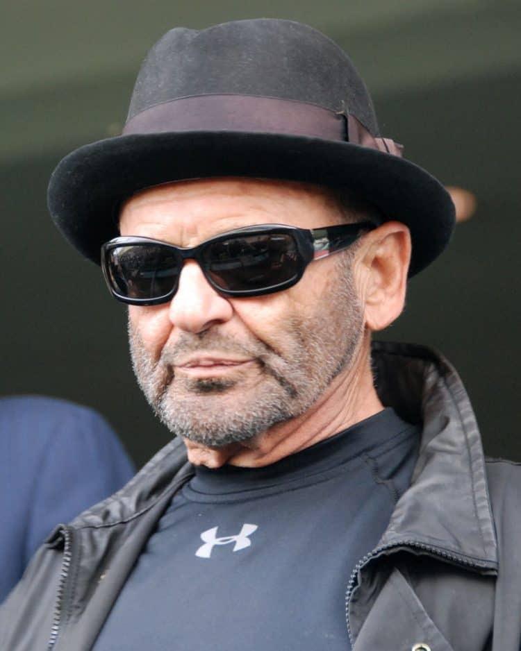 Goodfellas star Joe Pesci wearing shades and a pork pie hat