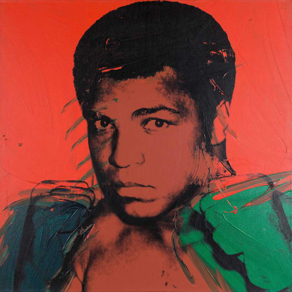 Muhammed Ali as painted by Andy Warhol in 1978. The picture is coloured red with Ali's features black and his fists green