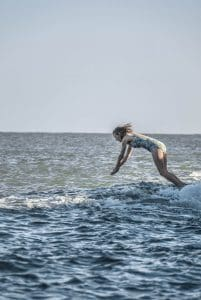 Ruth Fitzmaurice dives into cold sea water to go swimming