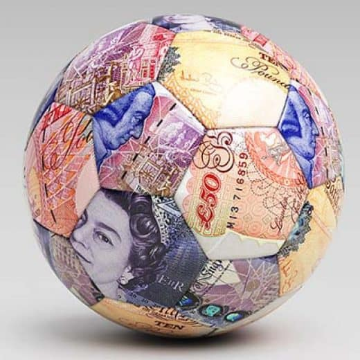 Football covered in english banknotes