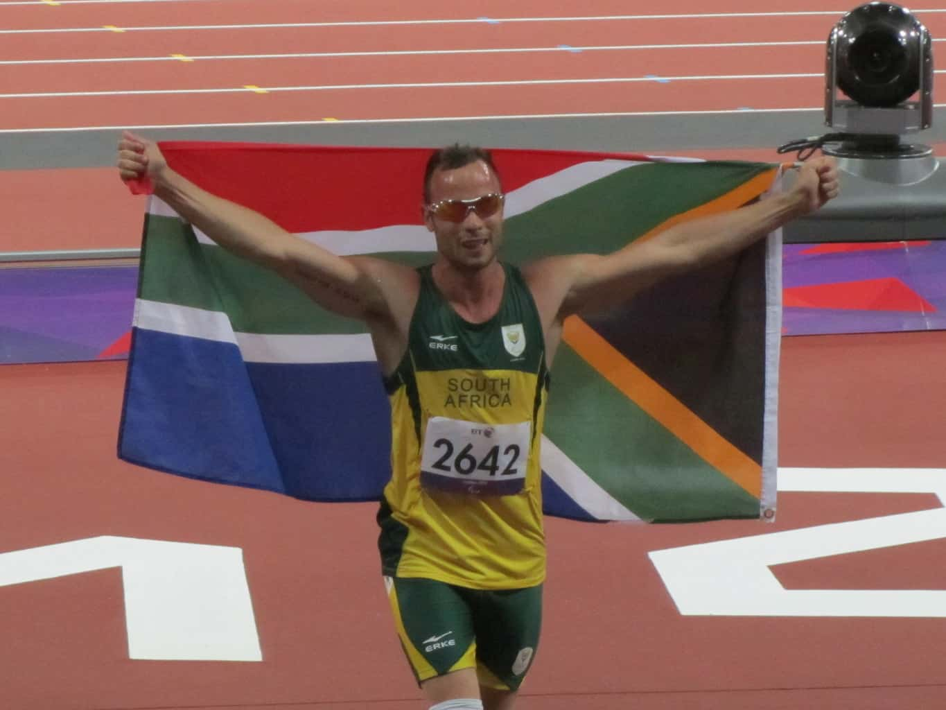 Oscar Pistorious celebrating with a South African flag