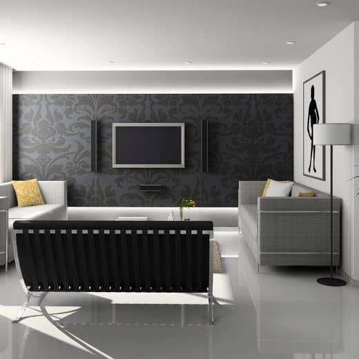 A stylish minimally furnished living area predominantly grey