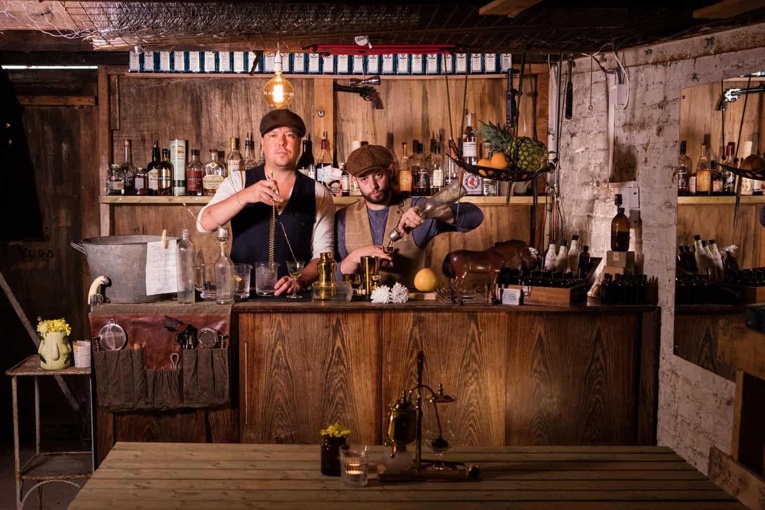 Chris Edwards & Dave Tregenza making winter cocktails behind a bar